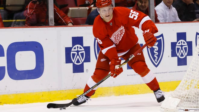 Detroit Red Wings left wing Teemu Pulkkinen skates with the puck against the Minnesota Wild at Joe Louis Arena.