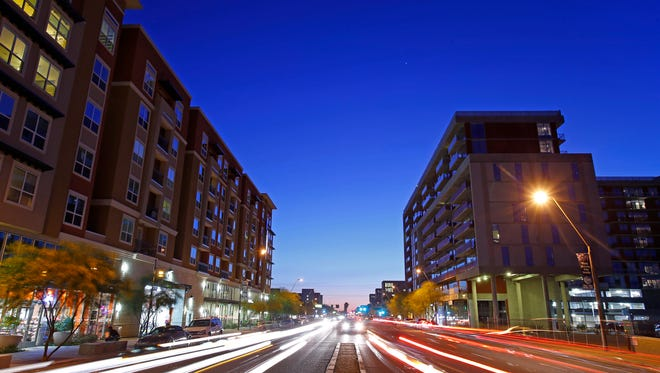 The District, left and 922 Place at right, along East Apache Blvd. Wednesday, April 15, 2015 in Tempe,  Ariz.