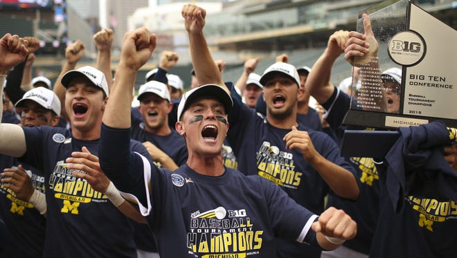 Michigan players sing their school's fight song after receiving the Big Ten championship trophy on Sunday, May 24, 2015, at Target Field in Minneapolis. Third-seeded Michigan beat fourth-seeded Maryland 4-3 in the championship game of the Big Ten baseball tournament.