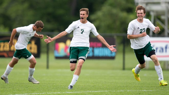 Beckman's Zach Deutmeyer (7) and Josh Gehling (27) celebrate the winning goal in the second overtime Saturday, June 6, 2015, during the IHSAA State Soccer Championships at Cownie Soccer Park in Des Moines.