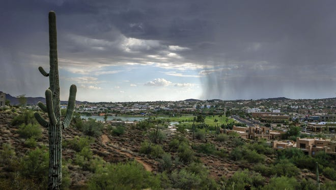Rain falls south of Fountain Park on Tuesday, Aug. 30, 2016, in Fountain Hills.