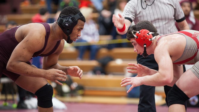 Tristan Schiafo of Red Hook and Nijee Noble of Kingston face off for the 152-pound title at the 51st Annual Mid-Hudson Wrestling Invitational at Arlington High School on Dec. 28.