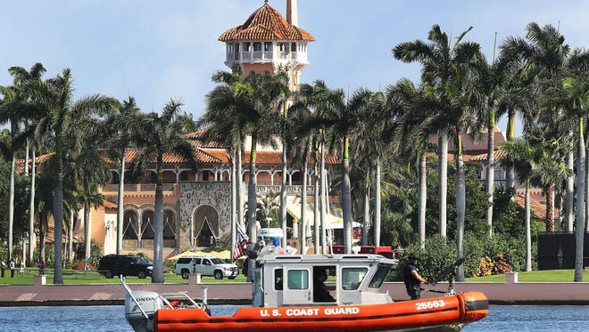 A U.S. Coast Guard boat passes in front of the Mar-a-Lago Resort where President Donald Trump  stays occasionally on weekends.