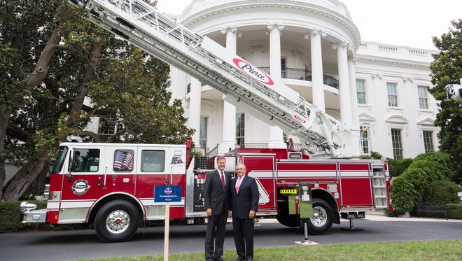 Pierce Manufacturing Co.'s   James Johnson and Jay Kimmitt with a fire truck at the White House.