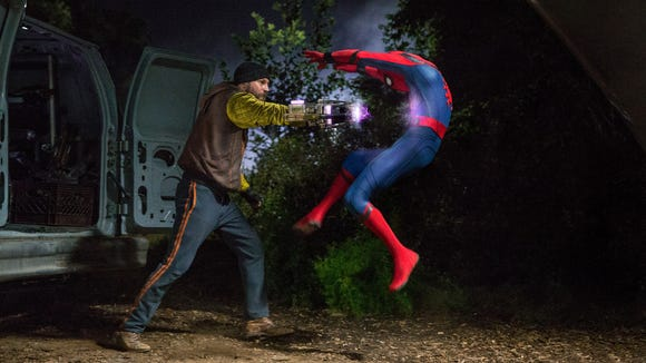 Teenage Spidey (Tom Holland, right) has to deal with supervillains like Shocker (Logan Marshall-Green) run amok in 'Spider-Man: Homecoming.'