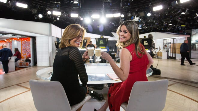 Savannah Guthrie toasts her co-host Hoda Kotb.
