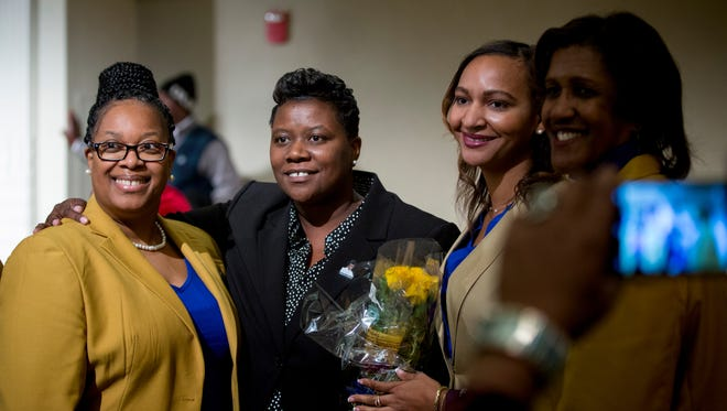 Tamaya Dennard poses for photos after she was sworn in as a city council member at the inaugural session of the city council held at the Music Hall ballroom Tuesday, January 2, 2018.