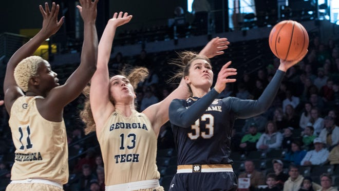 Notre Dame forward Kathryn Westbeld shoots as Georgia Tech forward Elo Edeferioka (11) and forward Lorela Cubaj (13) defend during the first half of an NCAA college basketball game Sunday, Jan. 7, 2018, in Atlanta.