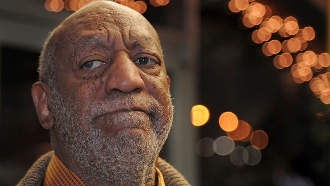 Bill Cosby pauses to talk to reporters, Wednesday, as he leaves following a dinner at an Italian restaurant in Philadelphia. The comedian, whose 2017 trial ended in a deadlocked jury, is set to be retried this spring.
