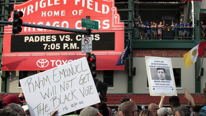 Demonstrators protest in front of Wrigley Field before  the start of the matchup between the Cubs and the Padres on August 2, 2018 in Chicago, Illinois. The demonstrators, who marched from Lake Shore Drive and through the nearby neighborhoods were protesting the ongoing violence, corruption and the lack of economic investments in African-American communities on the city's west and south sides.
