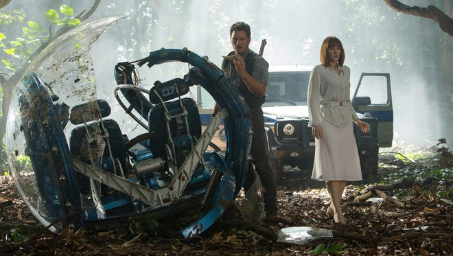 "This photo provided by Universal Pictures shows, Chris Pratt, left, and Bryce Dallas Howard in a scene from the film, ""Jurassic World,"" directed by Colin Trevorrow, in the next installment of Steven Spielberg's groundbreaking ""Jurassic Park"" series."