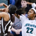 Aisha Jefferson (22) of MSU knocks the ball away from Armelia Horton of St. Bonaventure in the 1st half of their game Monday December 21, 2009 in East Lansing. Jefferson recovered the ball for Bonnie's turnover. KEVIN W. FOWLER PHOTO