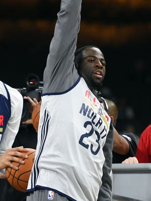 Western Conference forward Draymond Green of the Golden State Warriors (23) reacts after shooting a half court shot during NBA All-Star practice at the Mercedes-Benz Superdome on Saturday, Feb. 18, 2017.