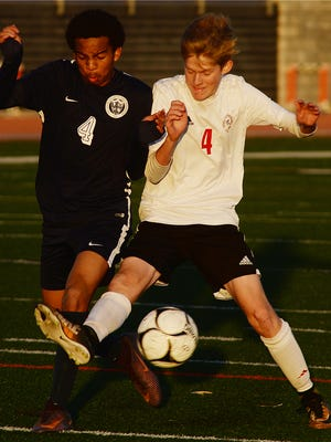 Santiago Merlos, left, of Aquinas battles with Foothill Tech's Max Turville in a CIF-SS Division 7 semifinal Tuesday at Ventura College. Foothill Tech lost 3-0.