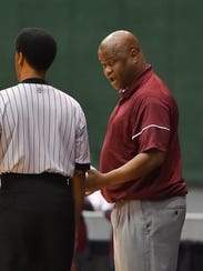 Okolona head coach Arteria Clifton has a word with