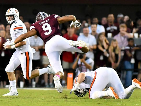 Oct 6, 2018; Starkville, MS, USA; Auburn Tigers quarterback Jarrett Stidham (8) runs the ball while being defended by Mississippi State Bulldogs  defensive end Montez Sweat (9) during the first quarter at Davis Wade Stadium. Mandatory Credit: Matt Bush-USA TODAY Sports