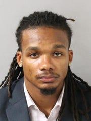 Brandon E. Banks, 23, was taken into custody on Friday,