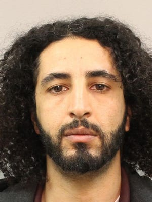 Ebrahim Albihani, 38, was arrested and faces four counts of distributing drug paraphernalia and one count of altering a gun's serial number, police said. His bond is $11,000.