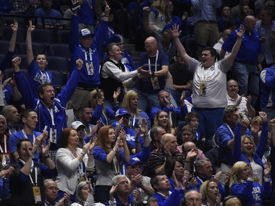 Kentucky fans are fixtures at the SEC Basketball Tournament  in Nashville. This group was ready to celebrate on March 11, 2016 at Bridgestone Arena.