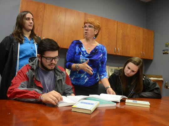 ANI Greek and Latin Recent NSU graduate Eleanor Drobina (back, left) and NSU students Nick Bailey and Chelsea Thibodeaux (far right) and T. Davina McLain, associate professor of classics (center) at NSU's Louisiana Scholars' College discuss the course offe