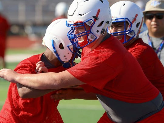 GABE HERNANDEZ/CALLER-TIMES Gregory-Portland's Jagger Weatherford runs through drills during practice Tuesday, Aug. 9, 2016, at Ray Akins Wildcat Stadium in Portland.