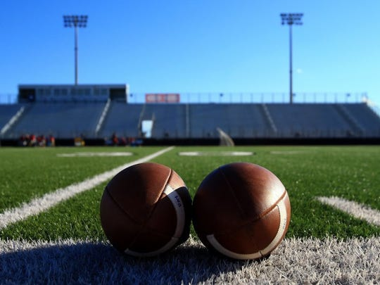 Two balls rest on the Cabaniss Stadium turf before Friday's game pitting King and Ray.
