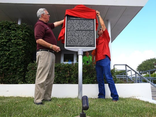 GABE HERNANDEZ/CALLER-TIMES Judge Loyd Neal (left) and Nueces County Precinct 1 Commissioner Mike Pusley unveil the historical marker for the Hilltop Tuberculosis Sanatorium during the dedication Friday, July 29, 2016, in Corpus Christi.