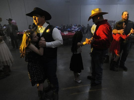 Thomas Metthe/Reporter-News   Billy Jones (left) dances with his daughter, Lyndie, 10, while Tim Garcia (center) dances with Nadia Garza, 8, during the 17th annual Daddy Daughter Date Night on Thursday, Feb. 11, 2016, at the Abilene Civic Center.