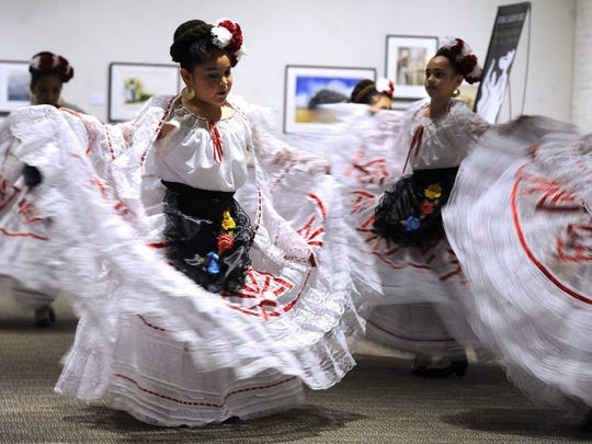 Dancers from Ballet Folklorico Del Big Country dance during a performance at the National Center for Children's Illustrated Literature on  April 16, 2016, during Big Day Downtown.
