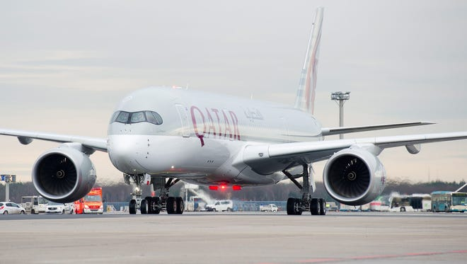 Qatar Airways' first Airbus A350 XWB rolls to the gate on at the Frankfurt airport on Jan. 15, 2015.