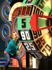 """A contestant competes on """"The Price is Right Live."""""""