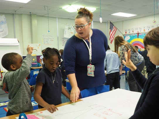 Melanie Quill leads first graders in math at Shortlidge Academy in Wilmington. Shortlidge is a priority school that now serves children in preschool through second grade.