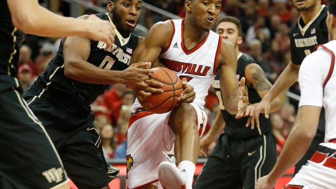 Louisville's Donovan Mitchell has the ball stripped away while driving to the basket. Jan. 3, 2016.