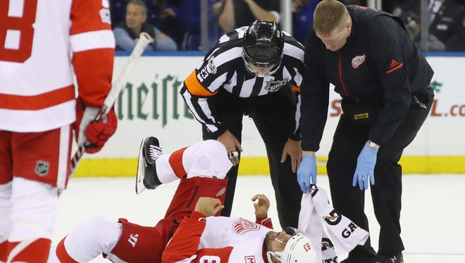 Red Wings defenseman Trevor Daley is attended to after an injury during the first period on Friday, Nov. 24, 2017, in New York.