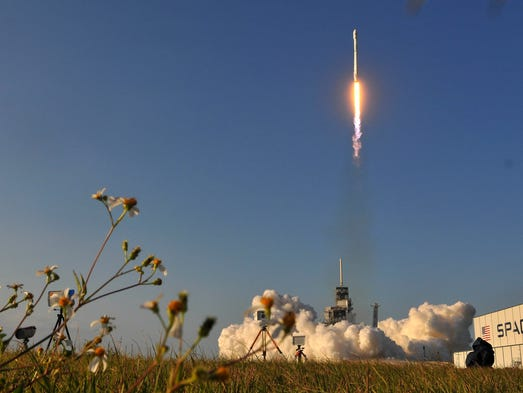 A SpaceX Falcon 9 rocket lifts off from Pad 39A at