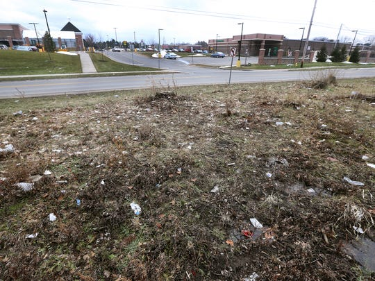This open field catches much of the litter that is blown there from customers of a nearby shopping plaza.  A large portion of that litter ends up in the yard of Robert and Ann Dobson who have lived in their Dobson Street home for 50 years.