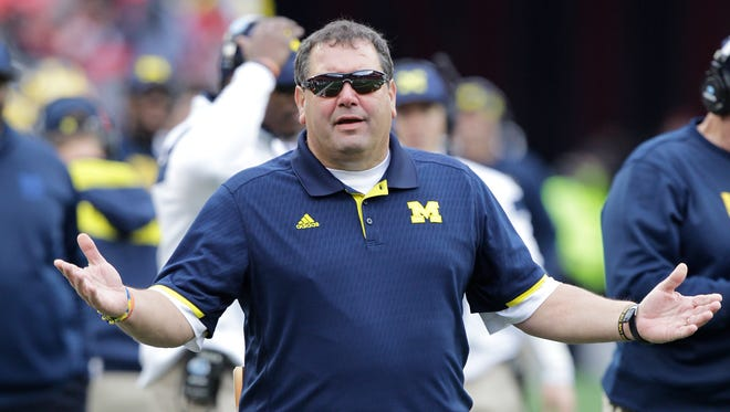 Michigan head coach Brady Hoke on the sidelines against Ohio State during an NCAA college football game Saturday, Nov. 29, 2014, in Columbus, Ohio.