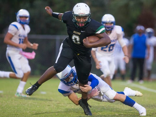 St. John Neumann running back Eddy Garcon slips past