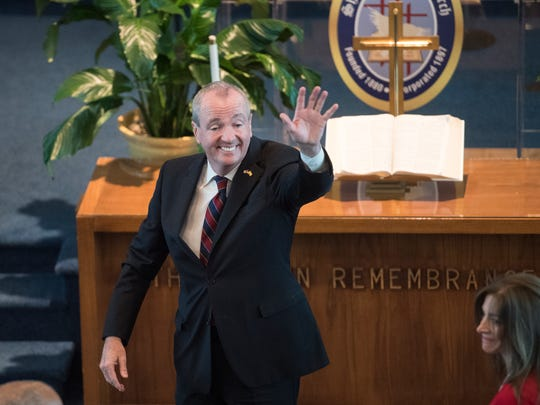Governor-elect Phil Murphy waves during the inaugural prayer service at Shiloh Baptist Church in Trenton on Tuesday, January 16, 2018.
