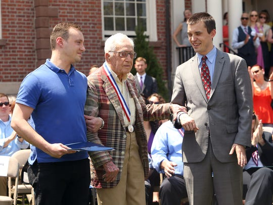 Christopher Donnelley of Morris Plains, l, and Morris County Freeholder Hank Lyon assist Distinguished Service Award medal recipient 99-year-old WWII Veteran Herman Rosenberg during the annual Morris County Memorial Day program on the courthouse lawn.  May 25, 2016, Morristown, NJ