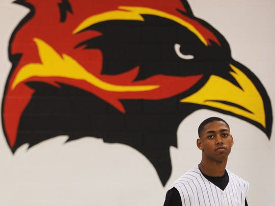 Tah're Pettit poses for a portrait inside the school's gym on Friday, March 4, 2016. Pettit is one of six seniors and is regarded as a leader on the Arcadia Firebird baseball team.