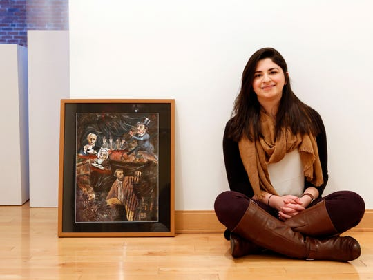 """Ursuline's Sabrina Greco, 18, with her work, """"A Dangerous Neighborhood,"""" at OSilas Gallery in Concordia College. Greco's multimedia piece sampled images from a book of Currier and Ives prints and put them into an environment all their own. The StART 2015 Regional High School Art Exhibition runs through Jan. 30."""