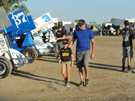 BR Motorsports' Blake Robertson and his daughter Ally speak before the race at Keller Auto Speedway at Kings Fairgrounds in Hanford on Sept. 17.