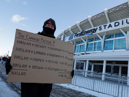 """A Cleveland Browns fan holds up a sign during the """"Perfect"""