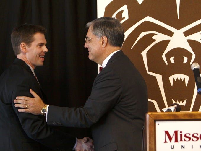 News mens basketball coach Paul Lusk (left) is greeted