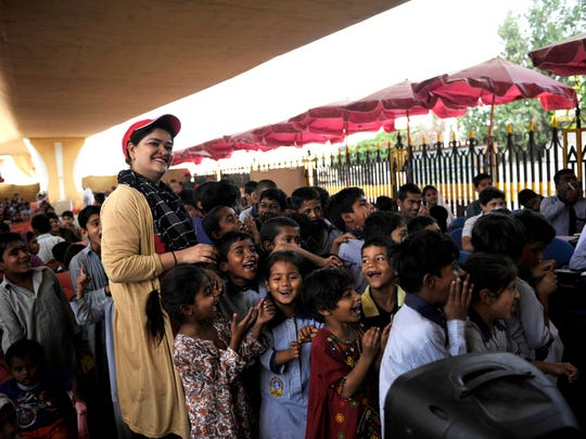 Students took a break from classes to sing and dance. The teachers at The Footpath School in Karachi, Pakistan, have faced threats by the government for their work but say they continue as they have a passion for the children they are helping.