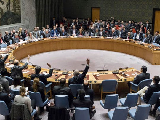 In this photo provided by the United Nations, members of the United Nations Security council vote at the United Nations headquarters on Friday, Dec. 23, 2016, in favor of condemning Israel for its practice of establishing settlements in the West Bank and east Jerusalem. In a striking rupture with past practice, the U.S. allowed the vote, not exercising its veto.