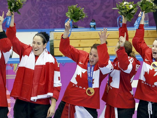 Team Canada celebrates after receiving the gold medal in the women's hockey final at the Winter Olympics in Sochi, Russia, on Thursday, Feb. 20, 2014. (Carlos Gonzalez/Minneapolis Star Tribune/MCT)