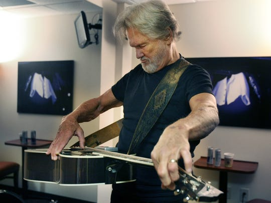 Kris Kristofferson tunes his guitar before his performance at the Great American Country studios on Aug. 25, 2009.