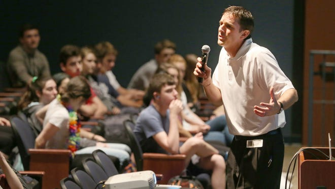 """Scott Fitch, Fairport High boys basketball head coach, gives his """"Pause Before You Post"""" presentation to students at Pittsford Sutherland High School Friday, May 19, 2017."""